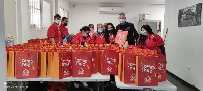 Meir Panim Team prepares Purim Packages